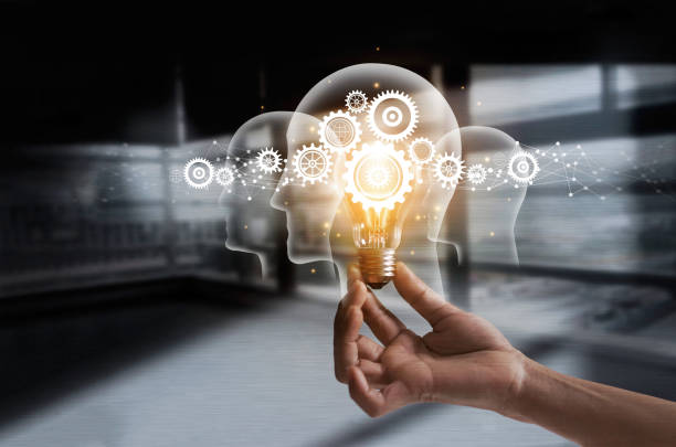 hand holding light bulb and cog inside. idea and imagination. creative and inspiration. innovation gears icon with network connection on human heads on metal texture background. innovative technology in science and industrial concept - active brain imagens e fotografias de stock
