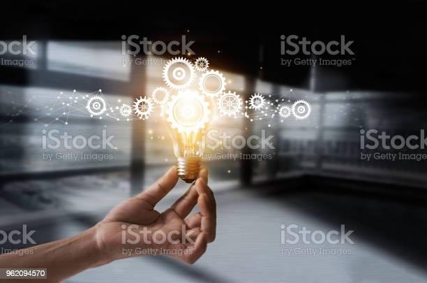 Hand holding light bulb and cog inside idea and imagination creative picture id962094570?b=1&k=6&m=962094570&s=612x612&h=y7azqyn4fh1eiu2scvkumazhzrossxlk apjjwwp6da=