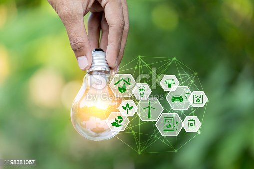 istock Hand holding light bulb with icons energy sources for renewable,love the world concept. 1198381057