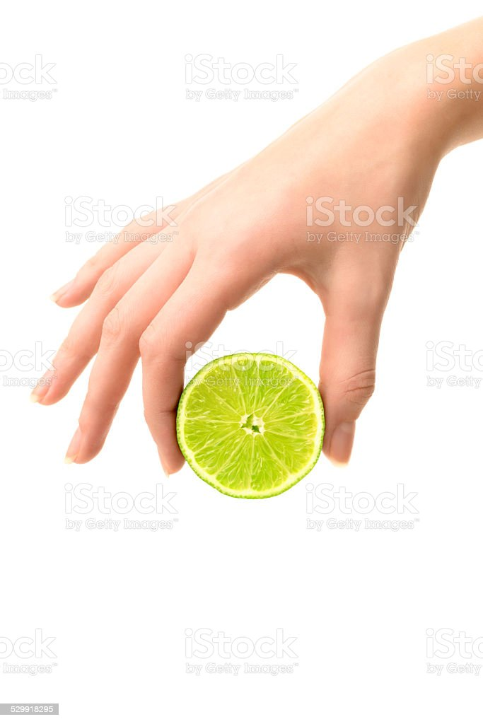 Hand holding lime stock photo