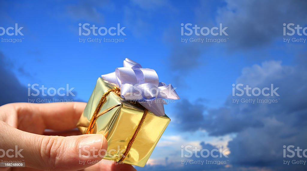 hand holding little gift box stock photo