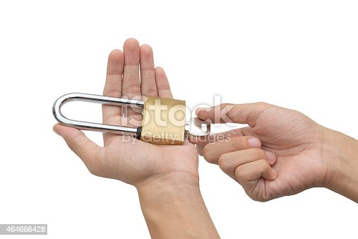 957759714istockphoto Hand holding, locking and unlocking brass padlock isolated 464666428