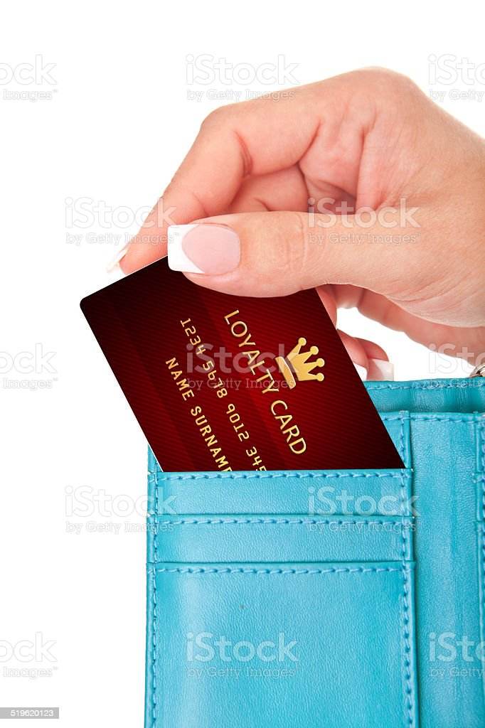 hand holding loyalty card in wallet isolated over white stock photo