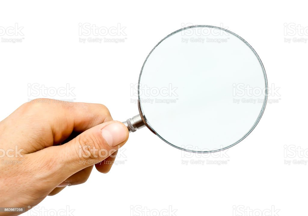Hand holding magnifying glass isolated on white background stock photo