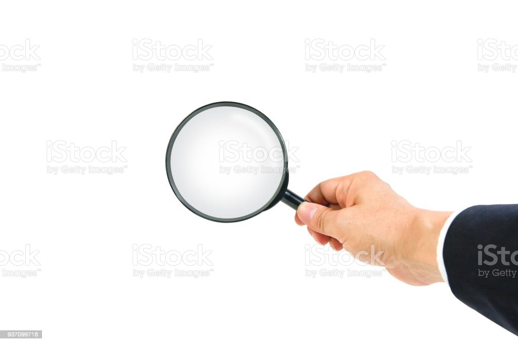 Hand holding magnifying glass, isolated on white background. stock photo