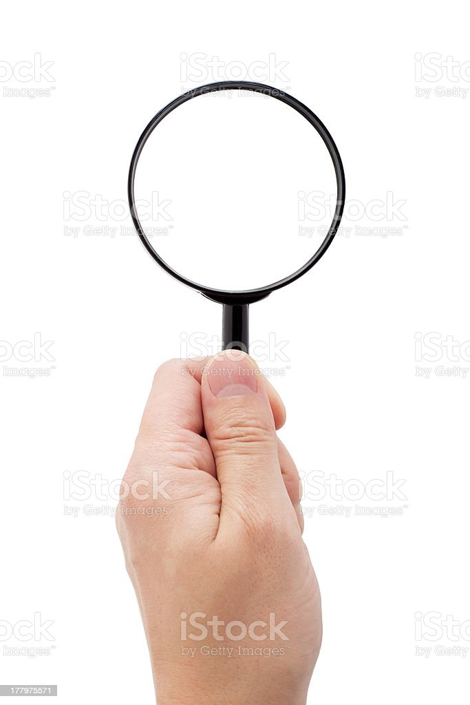 Hand holding magnifying glass royalty-free stock photo