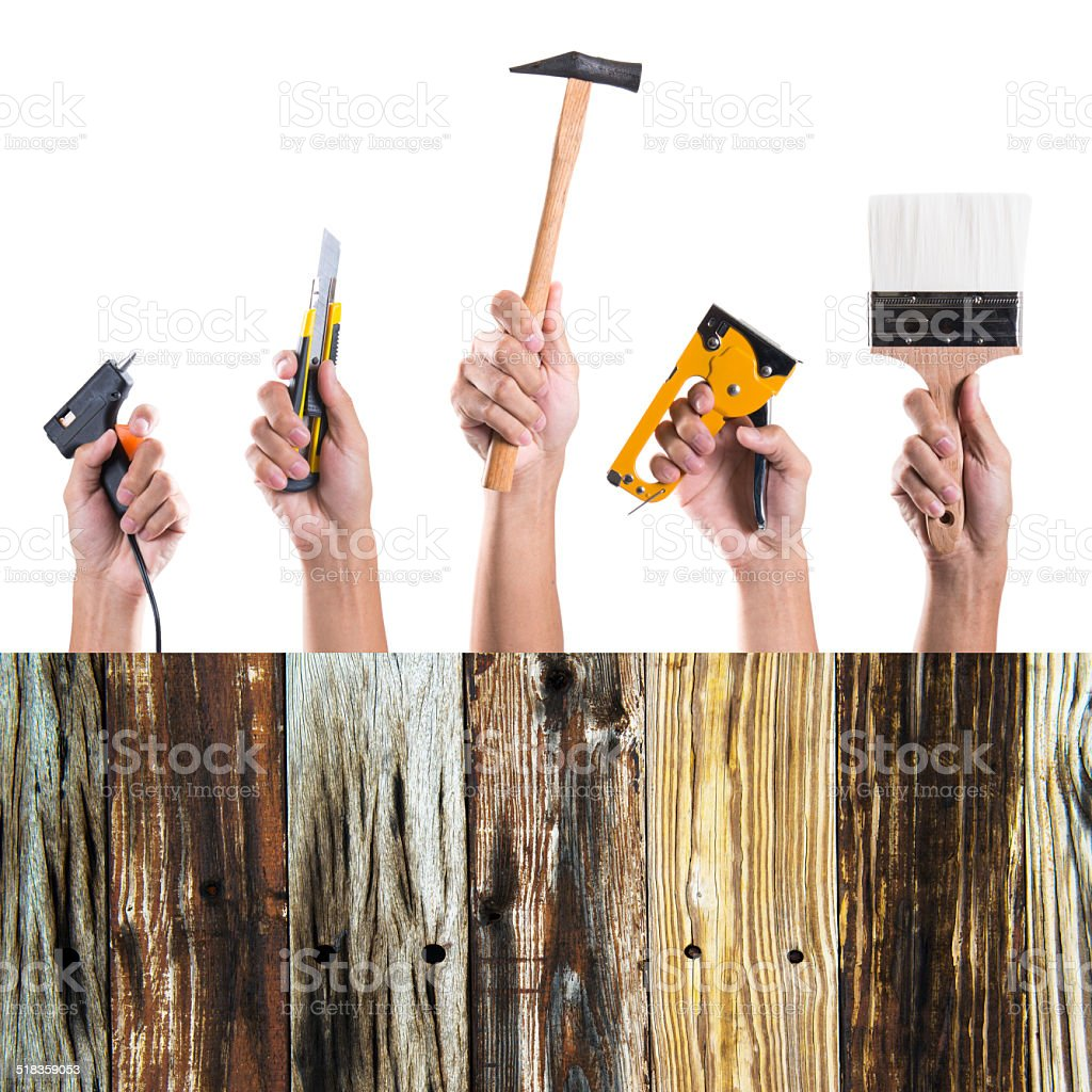 Hand holding many tools on white background