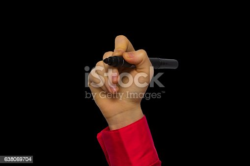 649719220 istock photo Hand holding marker isolated on black 638069704