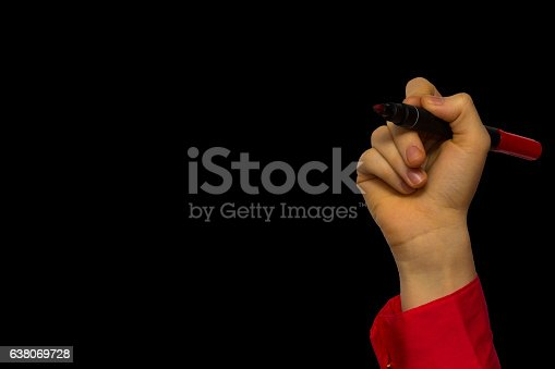 649719220 istock photo Hand holding marker isolated on black 638069728