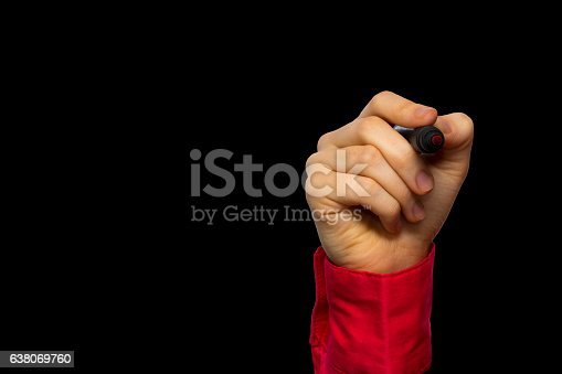 649719220 istock photo Hand holding marker isolated on black 638069760