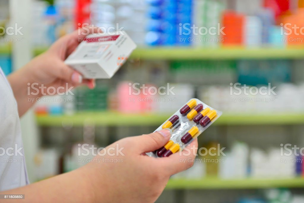 Hand holding medicine capsule pack stock photo