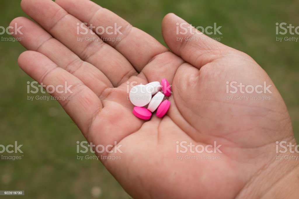 Hand holding medicine pills. stock photo