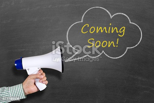 843847560 istock photo Hand holding megaphone with Coming Soon announcement 511795536