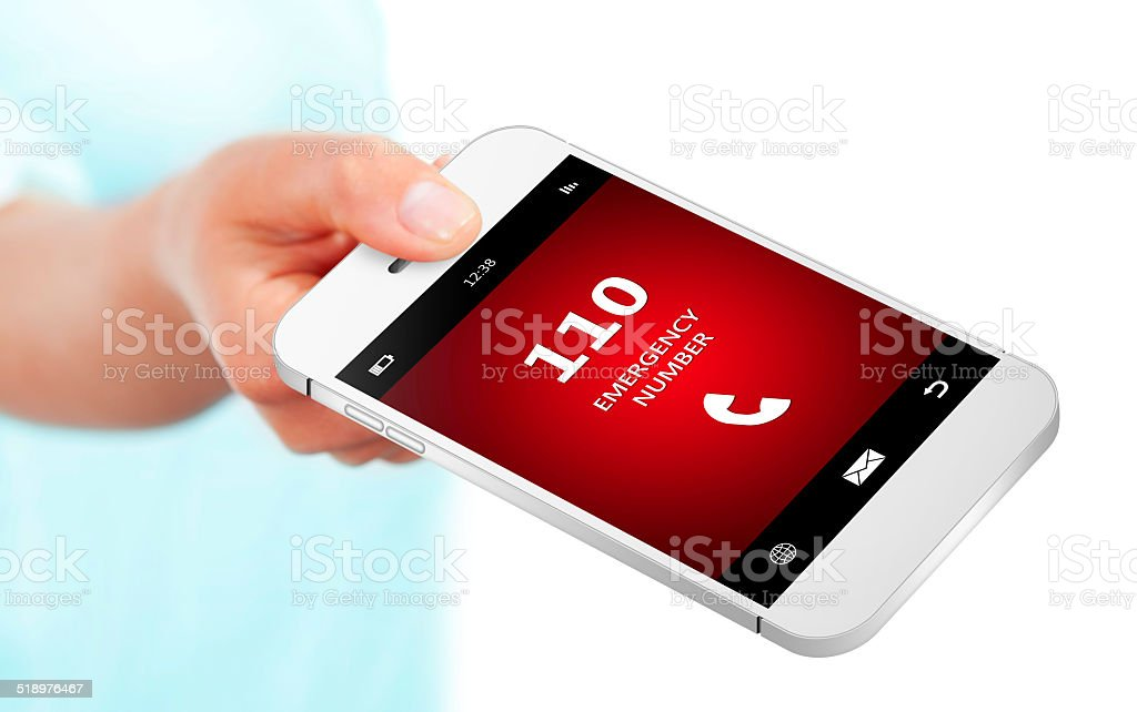 hand holding mobile phone with emergency number 110 stock photo
