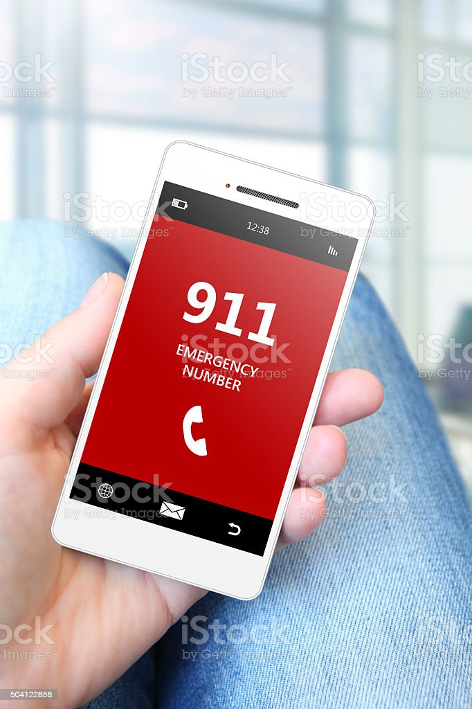 hand holding mobile phone with emergency number 911 stock photo