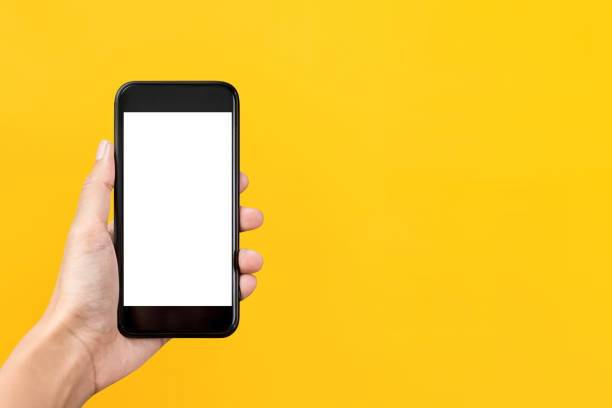 Hand holding mobile phone with empty screen stock photo