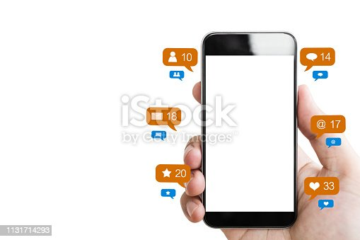 istock Hand holding mobile smart phone, blank empty screen and online social networking notification icons, isolated on white background 1131714293