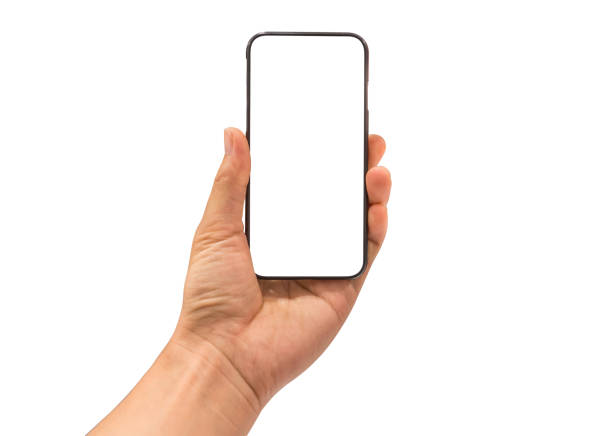 Hand holding mobile smart phone, blank white screen on white background stock photo