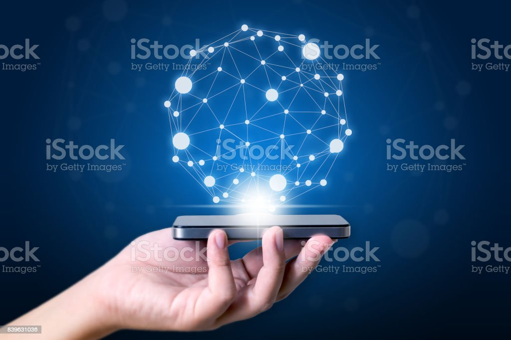 Hand holding mobile smart phone, concept world connected and social network stock photo