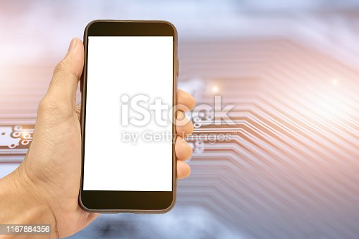 istock Hand holding Mobile Smart phone on PCB circuit background Technology communication concept 1167884356