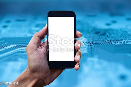 istock Hand holding Mobile Smart phone on PCB circuit background Technology communication concept 1167884416