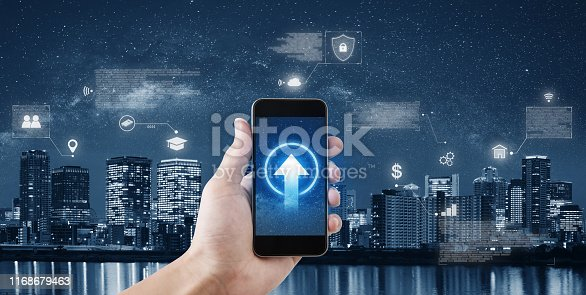 1075752640istockphoto Hand holding mobile smartphone connect to internet data and online application 1168679463