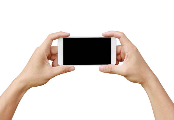 Hand holding mobile smartphone with blank screen. Mobile photography concept. Isolated on white. stock photo