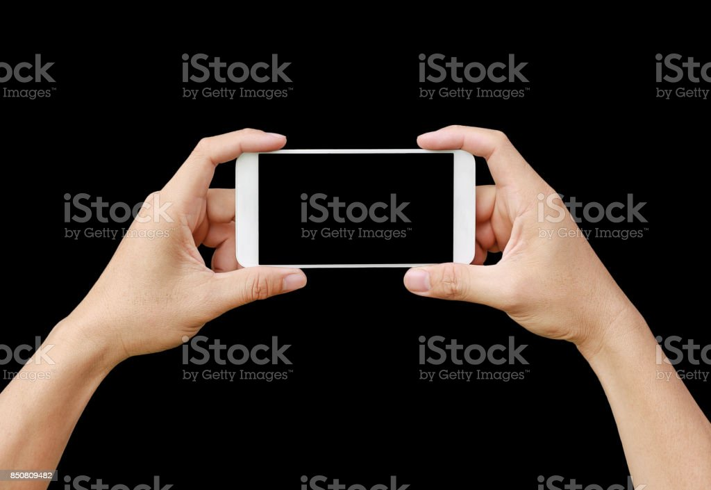 Hand holding mobile smartphone with blank screen. Mobile photography concept. Isolated on black. stock photo