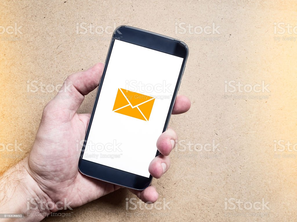 Hand holding mobile smartphone with message on a screen stock photo