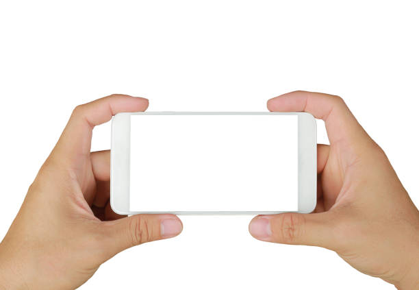 Hand holding mobile smartphone with white screen. Mobile photography concept. Isolated on white. stock photo