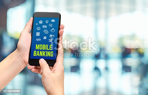 istock Hand holding mobile with mobile banking apps on smartphone screen at cafe restaurant,Digital lifestyle,modern financial business concept. 1014648996