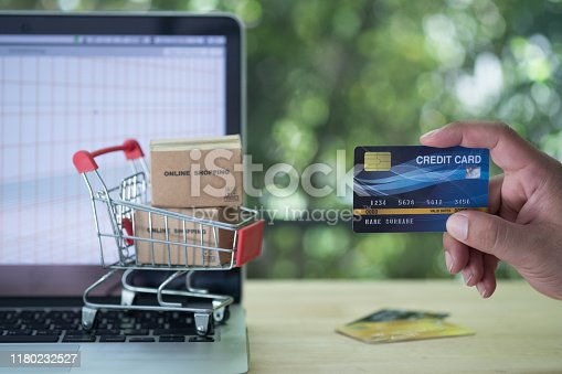 Hand holding mock up of credit card. Consumer can buy products anywhere anytime from seller