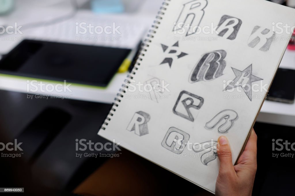 Hand Holding Notebook With Drew Brand Logo Creative Design Ideas stock photo