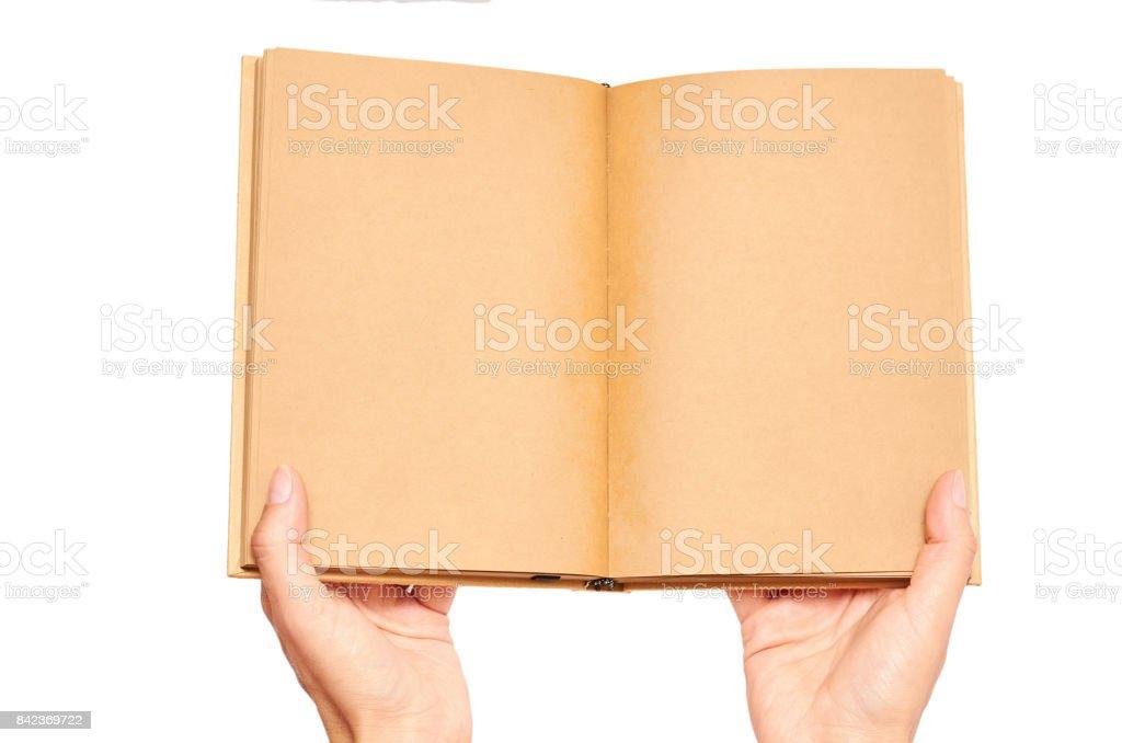 hand holding notebooks isolated on white background stock photo