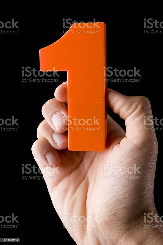 hand holding number one royalty-free stock photo