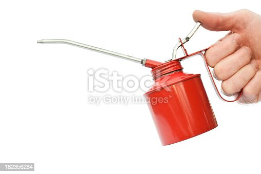 Human hand holding an oil can against a pure white background