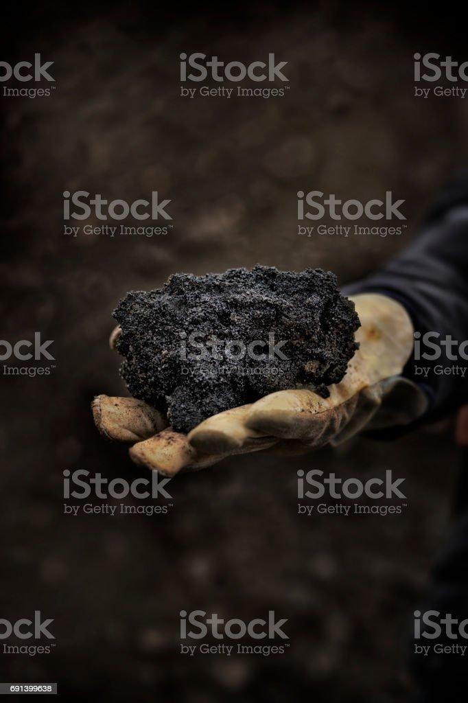 Hand Holding Oilsands Bitumen stock photo