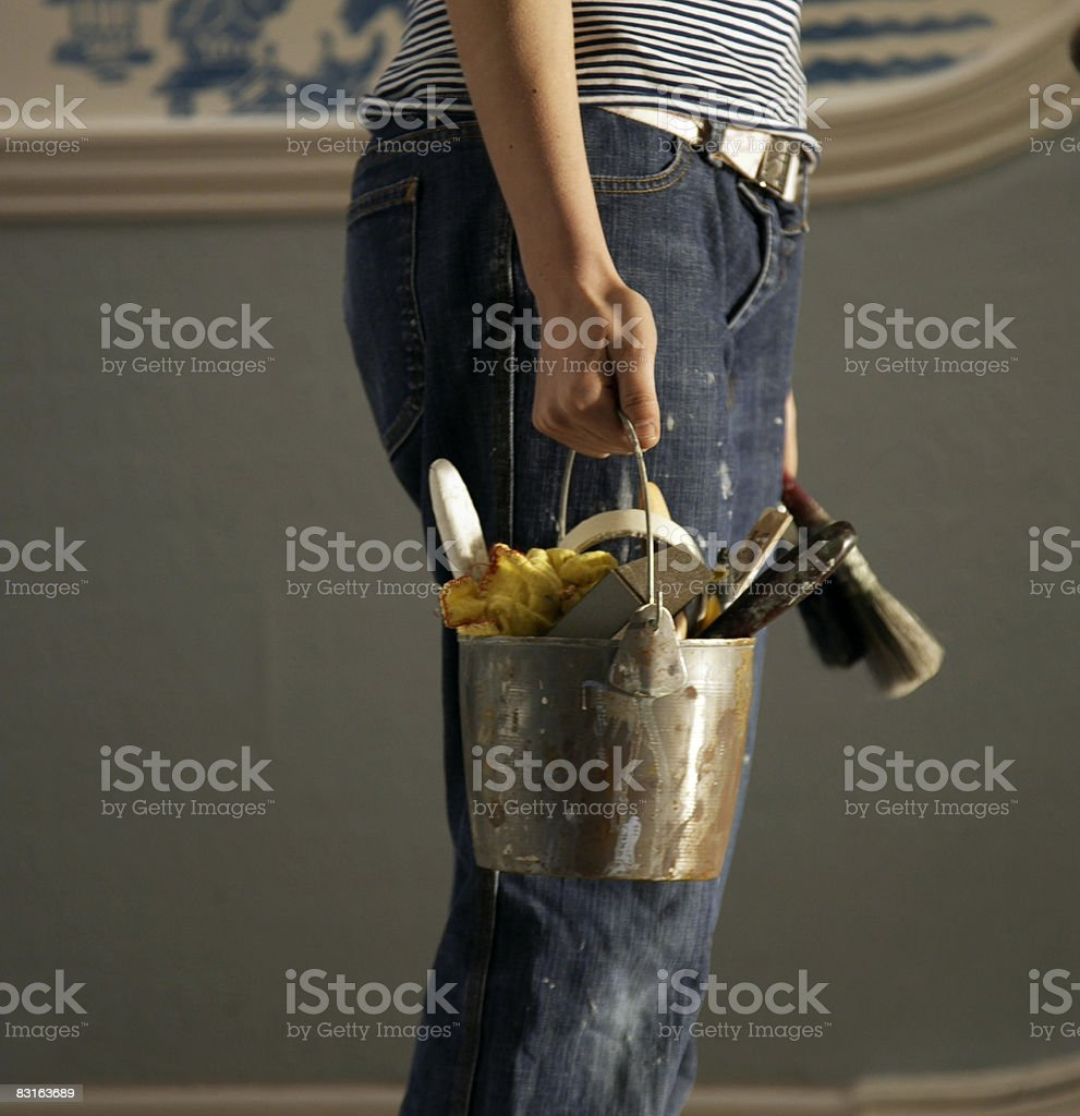 Hand holding old bucket of DIY tools royalty-free stock photo