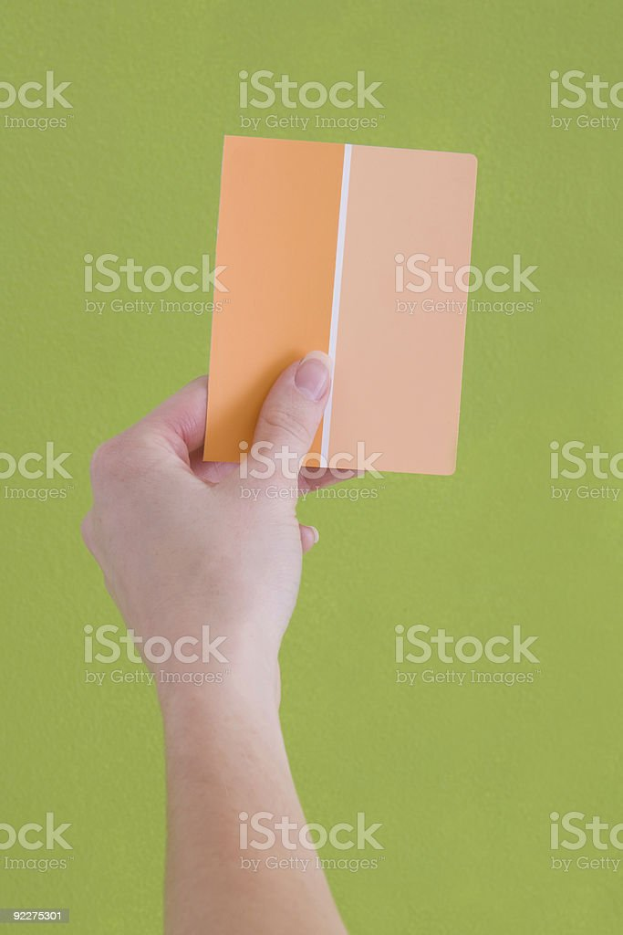 Hand Holding Orange Paint Samples royalty-free stock photo