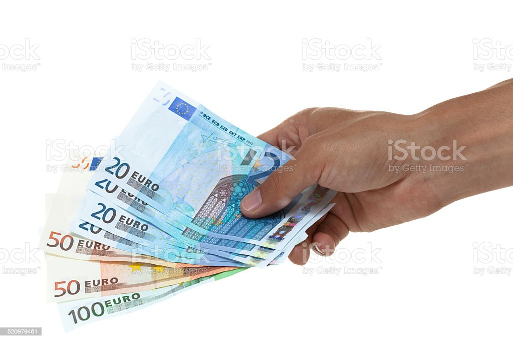 Hand holding out a fan of euro bills stock photo