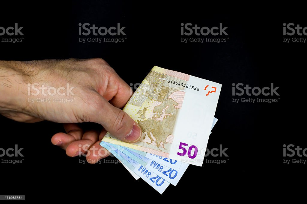 hand holding out some banknotes stock photo