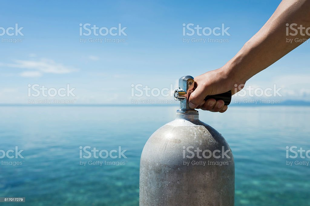 Hand Holding Oxygen Cylinder stock photo