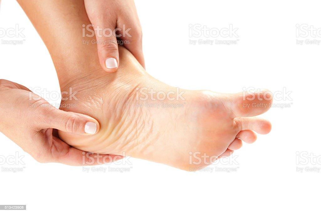Hand holding painful heel stock photo