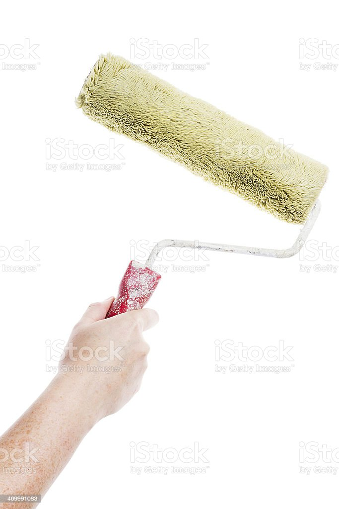 Hand holding paint roller royalty-free stock photo