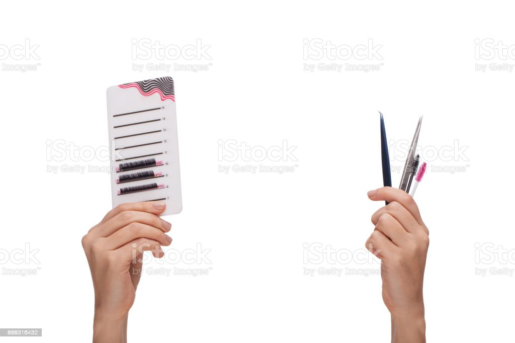 Hand holding a palette with extended eyelashes, second hand tools for...