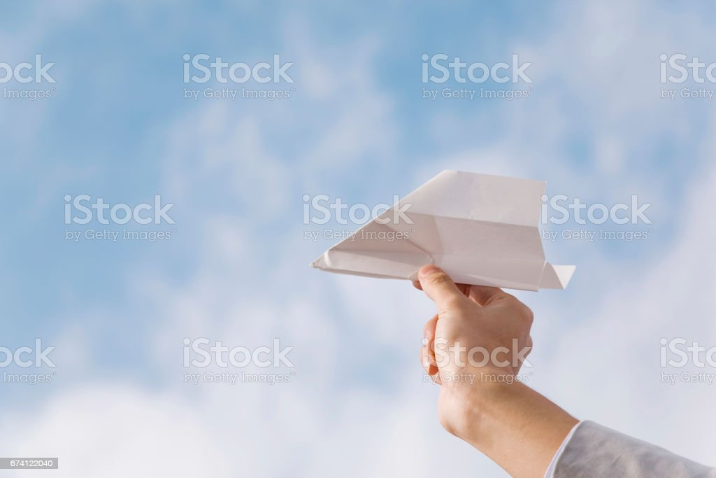 Hand holding paper airplane royalty-free stock photo