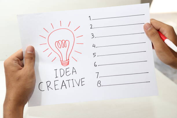 hand holding paper of idea creative form list stock photo
