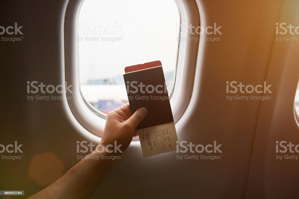 Hand holding passport stock photo