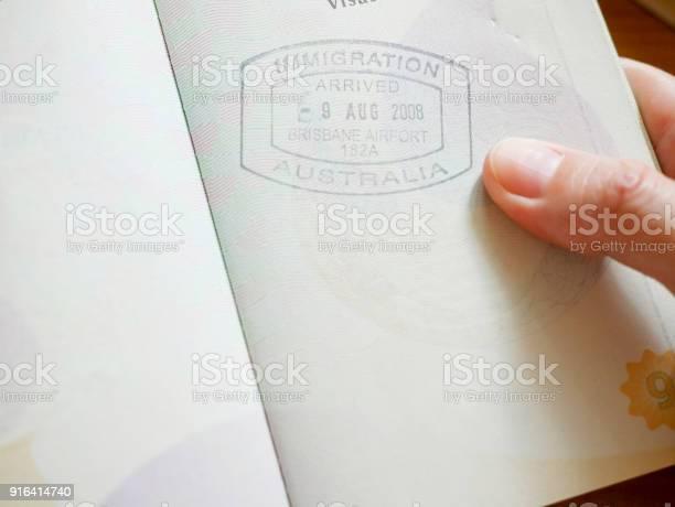 Hand holding passport with australian immigration stamp picture id916414740?b=1&k=6&m=916414740&s=612x612&h=74izmi3emgpgurpgw2rhbp8wqfzwmqwgefgfb ptfj4=
