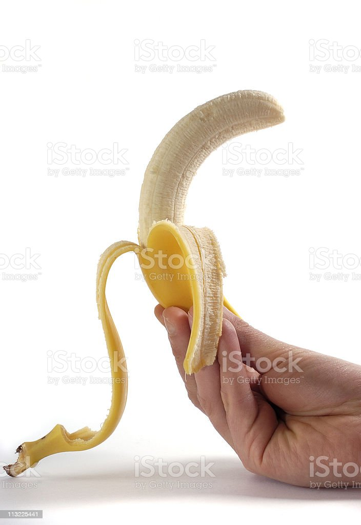 hand holding peeled banana royalty-free stock photo